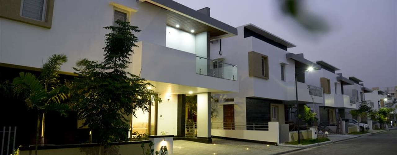 MODERN HOUSE WITH CLASSICAL TOUCH:  Houses by KREATIVE HOUSE