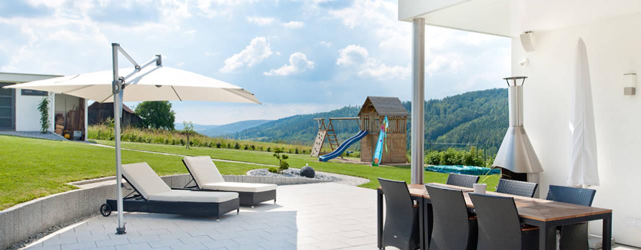 Eclectische balkons, veranda's en terrassen van homify Eclectisch