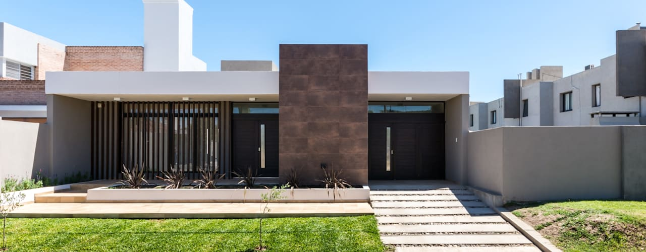 Casas modernas de KARLEN + CLEMENTE ARQUITECTOS Moderno
