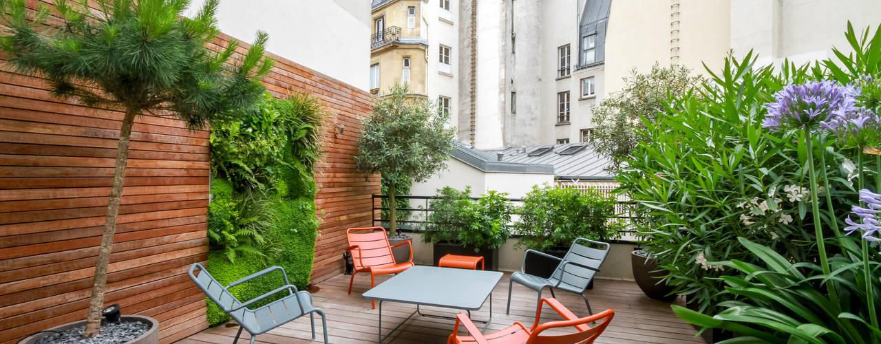 بلكونة أو شرفة تنفيذ Terrasses des Oliviers - Paysagiste Paris,