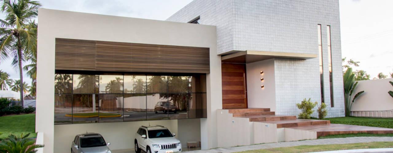 منازل تنفيذ Carolina Mota - Arquitetura, Interiores e Iluminação,