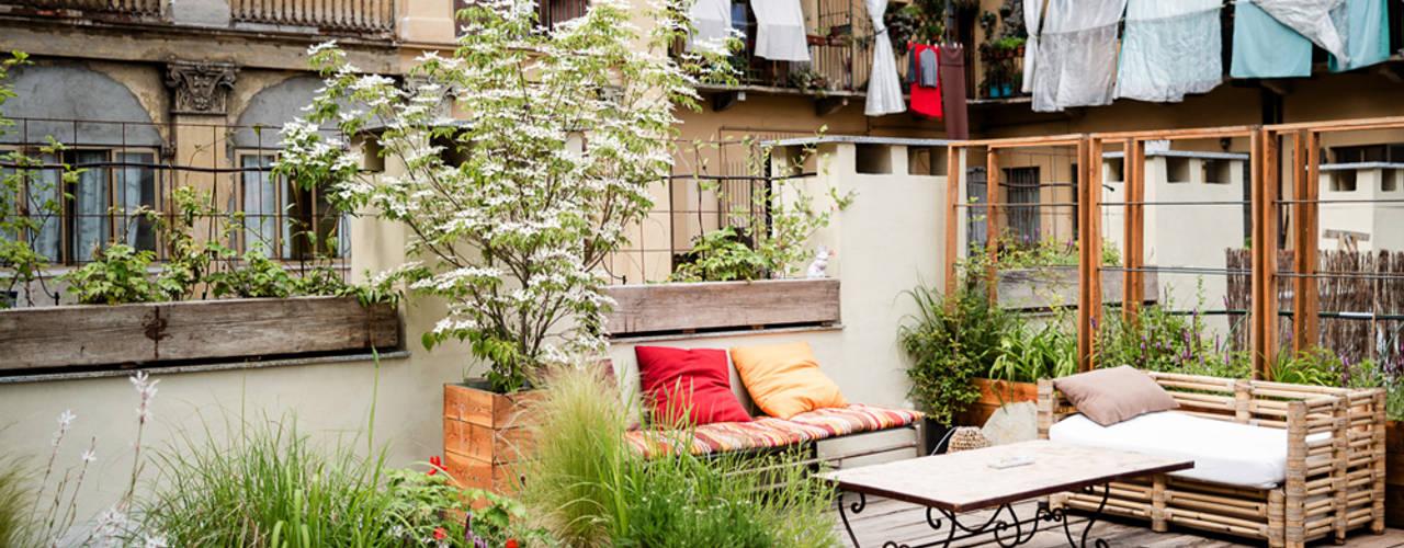 marta carraro Rustic style balcony, veranda & terrace