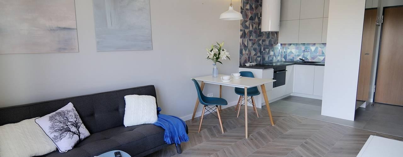 Skandynawskie mieszkanie w Krakowie.: styl , w kategorii Salon zaprojektowany przez ARTEMA  PRACOWANIA ARCHITEKTURY  WNĘTRZ