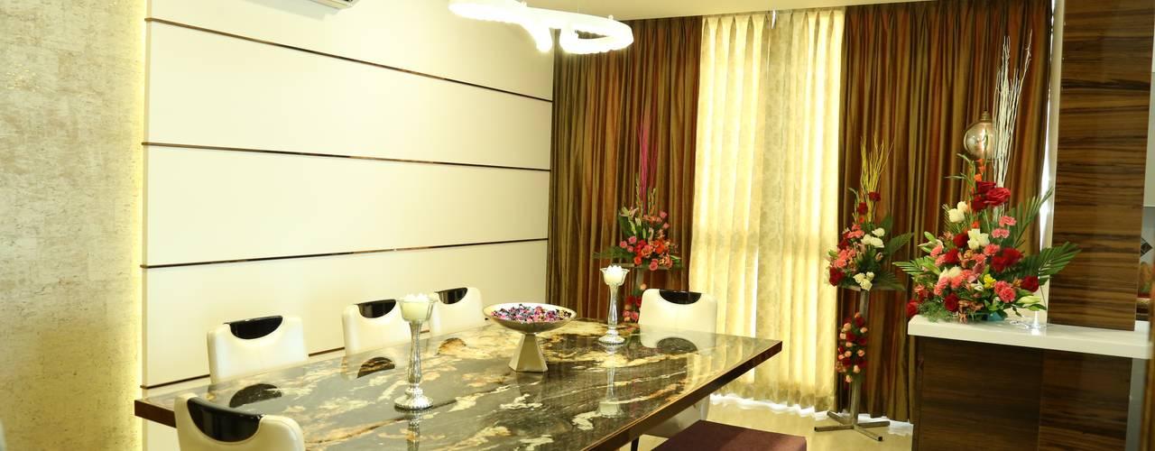 Apartment interiors at Sattva Luxuria Modern dining room by Studio Stimulus Modern