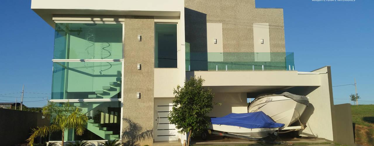 Residência de veraneio por Monteiro arquitetura e interiores Moderno