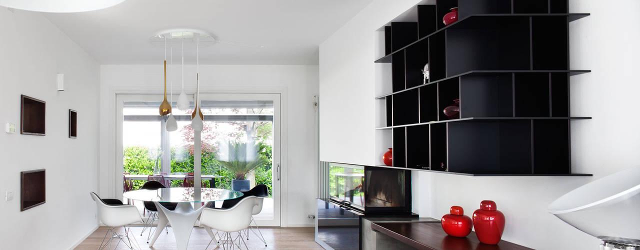 Salas de estar  por EXiT architetti associati