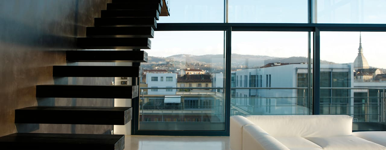 LOFT CUBE: Ingresso & Corridoio in stile  di Studio Fabio Fantolino