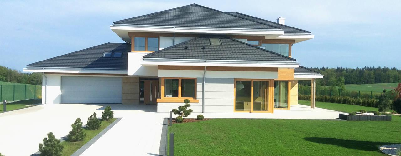 Casas de estilo  por MG Projekt Projekty Domów, Moderno