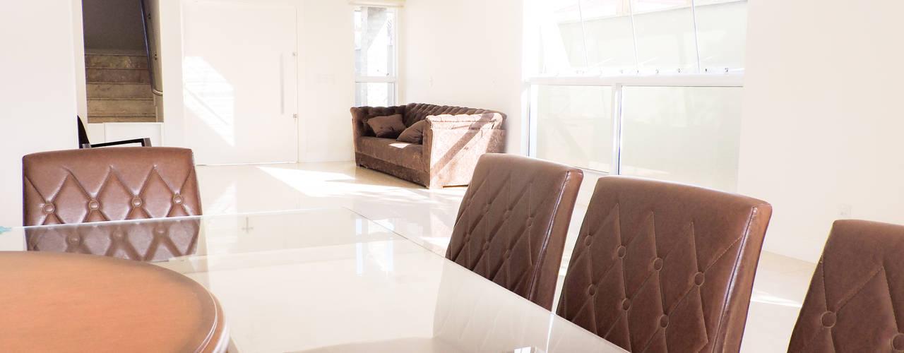moderne Eetkamer door Cecyn Arquitetura + Design