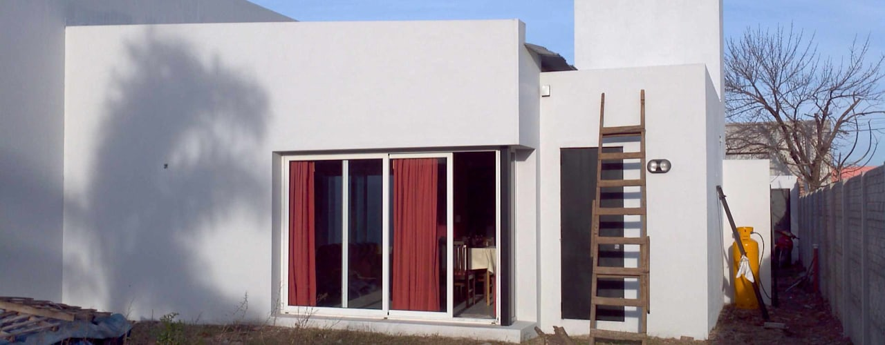 Casas de estilo ecléctico por Patricio Galland Arquitectura