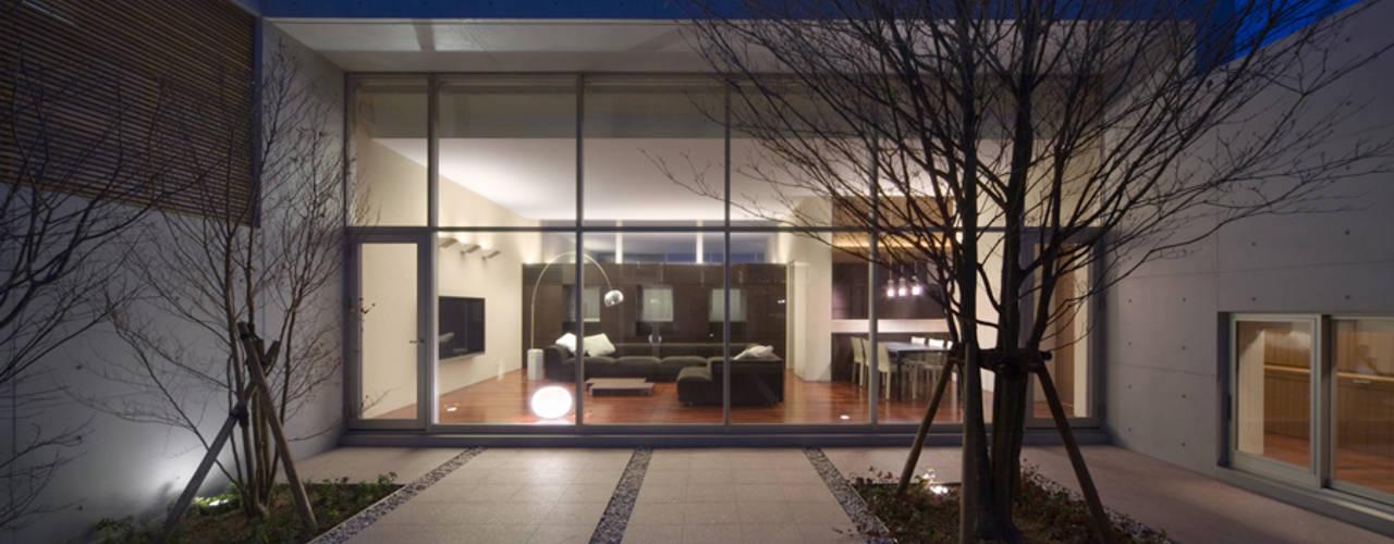 Atelier Square Jardines de estilo moderno Concreto