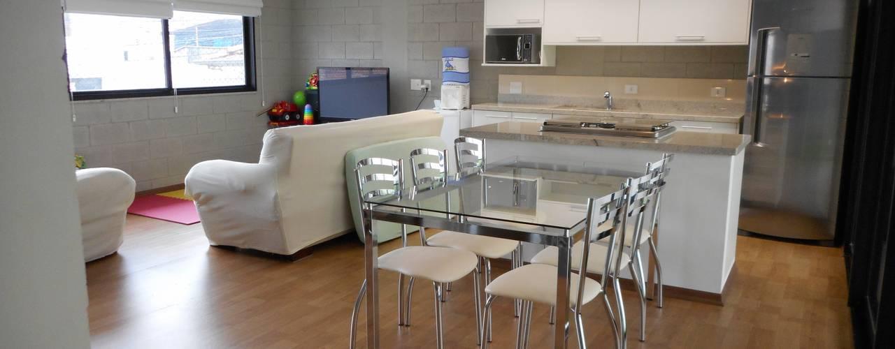 Casa de bloco aparente Salas de jantar rústicas por Metamorfose Arquitetura e Urbanismo Rústico