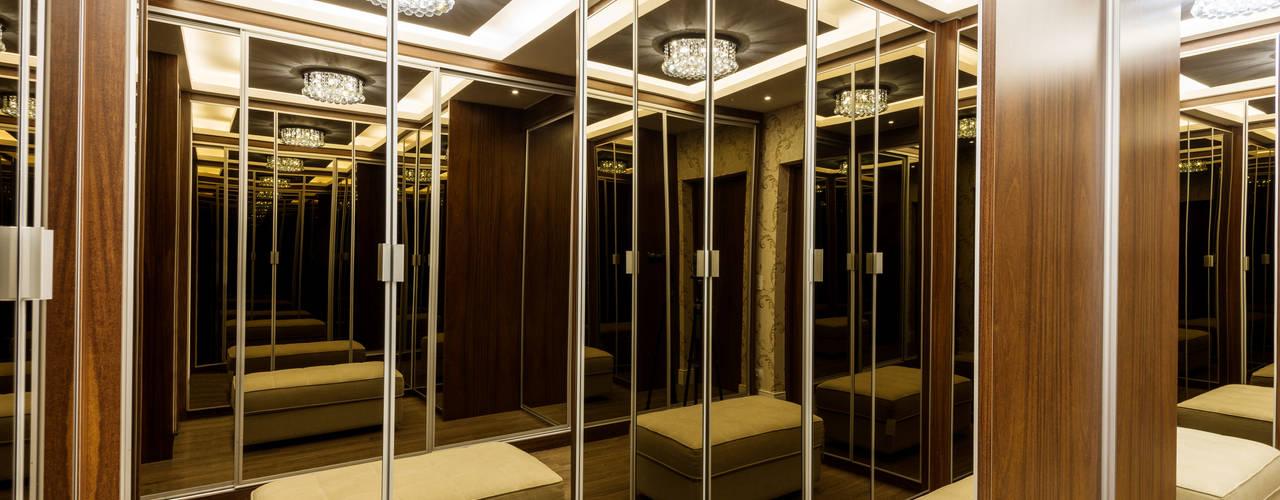 Dressing room by Designer de Interiores e Paisagista Iara Kílaris