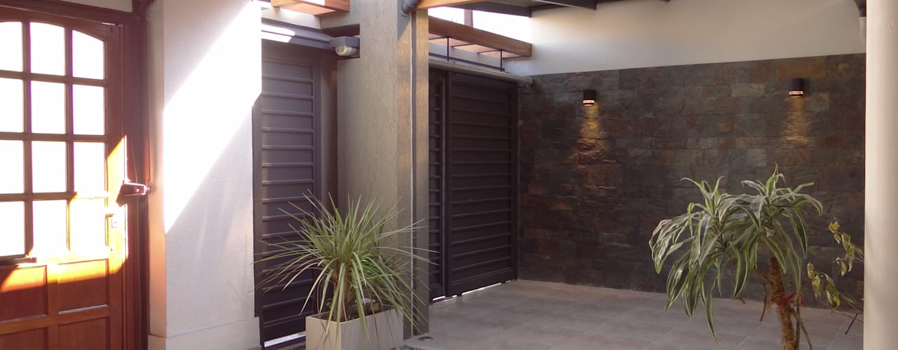 Casas de estilo  por D'ODORICO OFICINA DE ARQUITECTURA