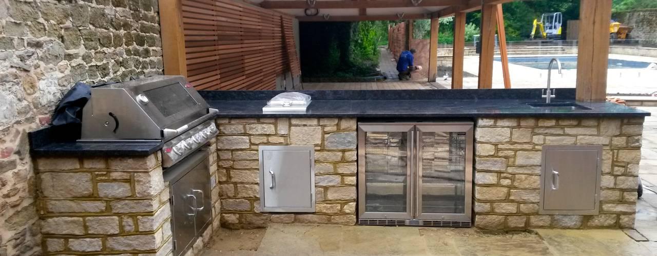 outdoor kitchen Jardines de estilo moderno de wood-fired oven Moderno