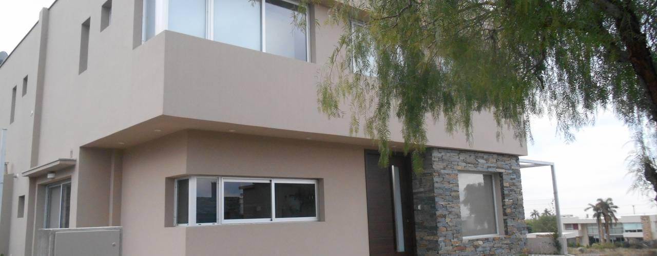 Casas de estilo moderno de MABEL ABASOLO ARQUITECTURA Moderno