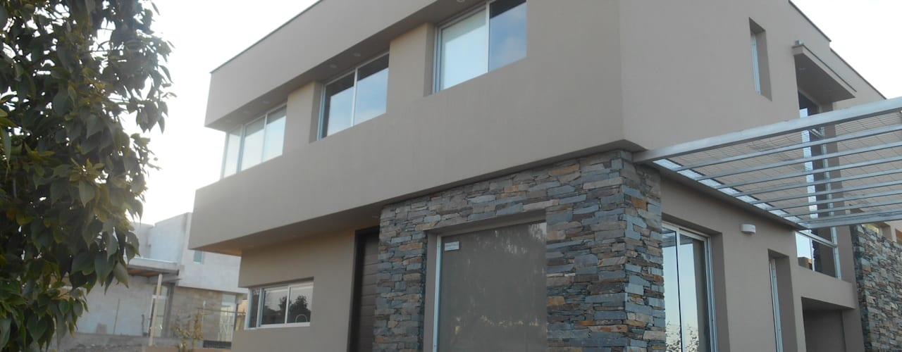 Casas de estilo  por MABEL ABASOLO ARQUITECTURA