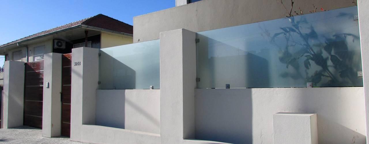 Projekty, nowoczesne Domy zaprojektowane przez G7 Grupo Creativo