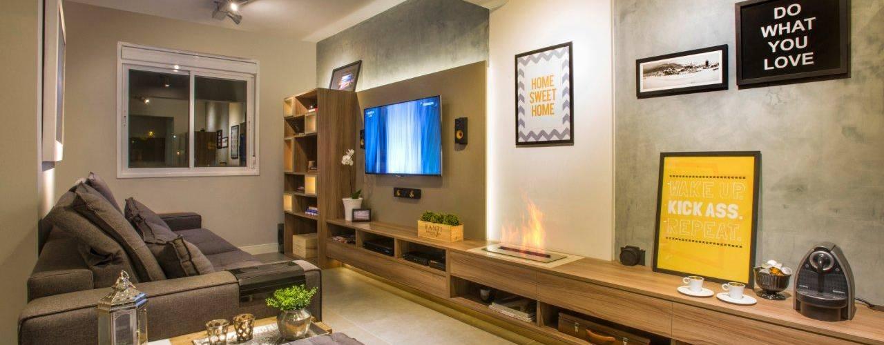 Integrado e para receber: Salas de estar  por C. Arquitetura