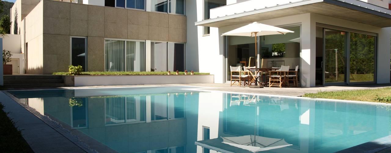 Viana House Piscinas modernas por Valdemar Coutinho Arquitectos Moderno