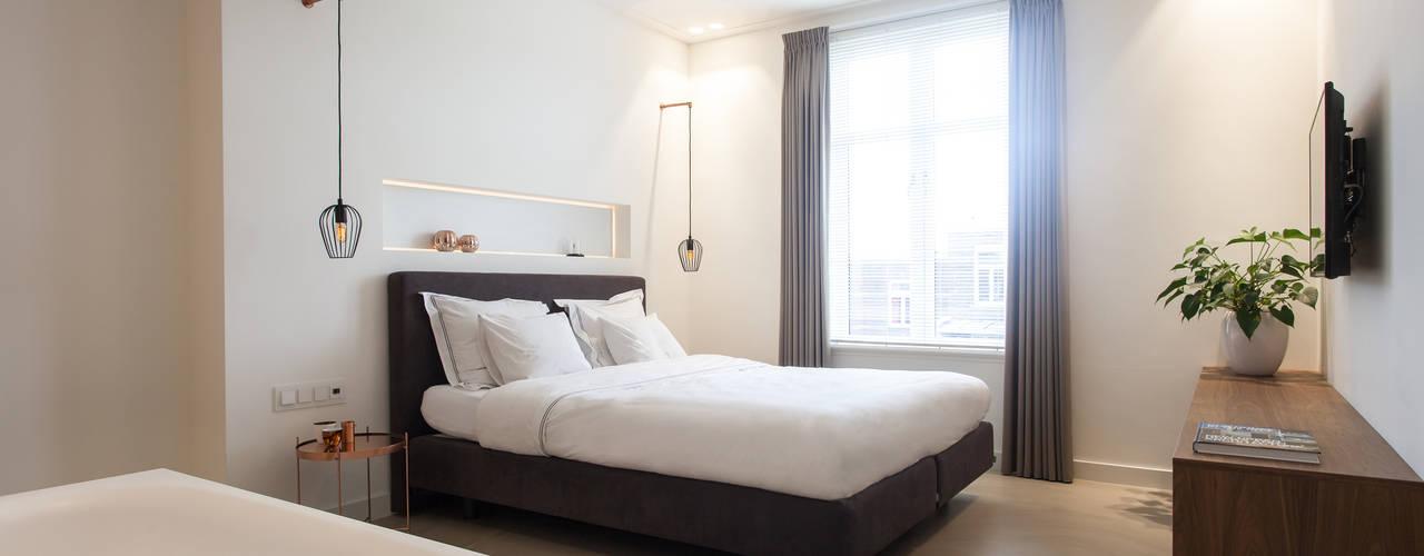 Slaapkamer/badkamer:  Slaapkamer door Bob Romijnders Architectuur & Interieur