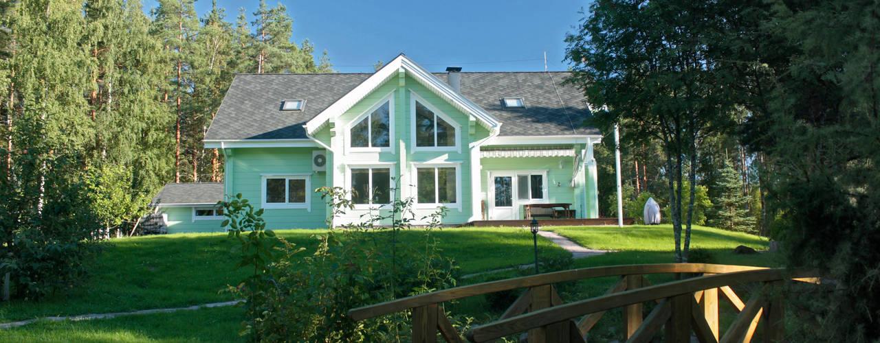 Загородный дом из клееного бруса Дома в рустикальном стиле от Дмитрий Кругляк Рустикальный