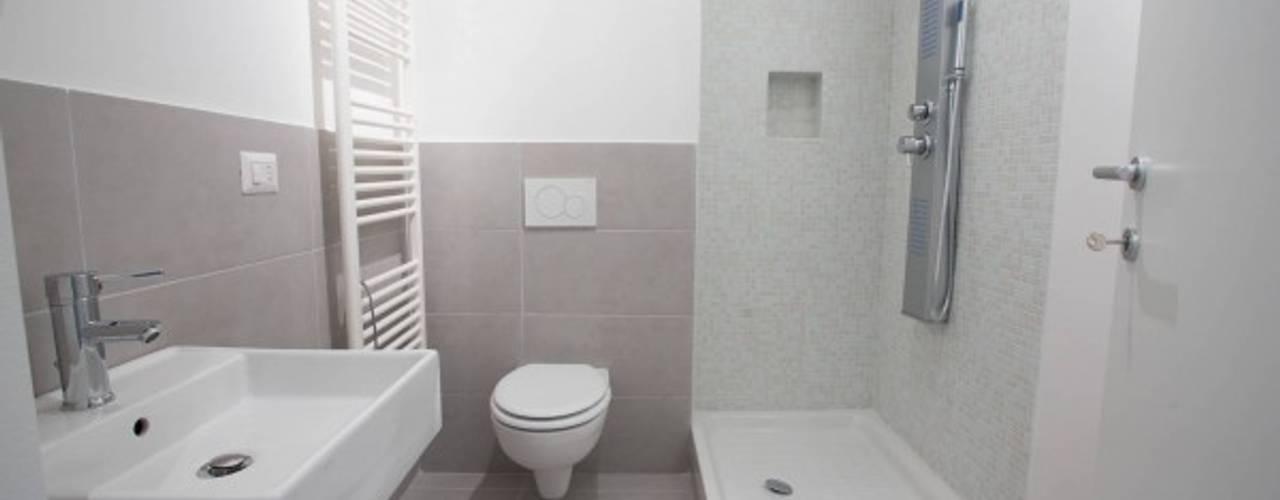 Casas de banho modernas por MmArchi.  I  Monica Maraspin Architetto