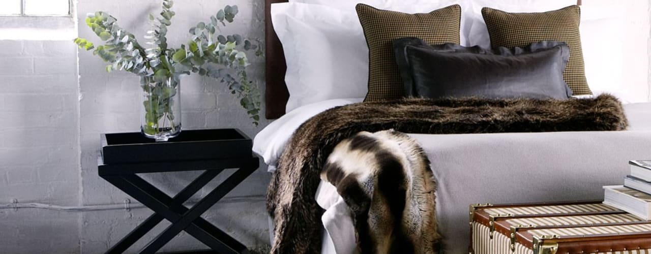 Dormitorios de estilo moderno por Conexo.