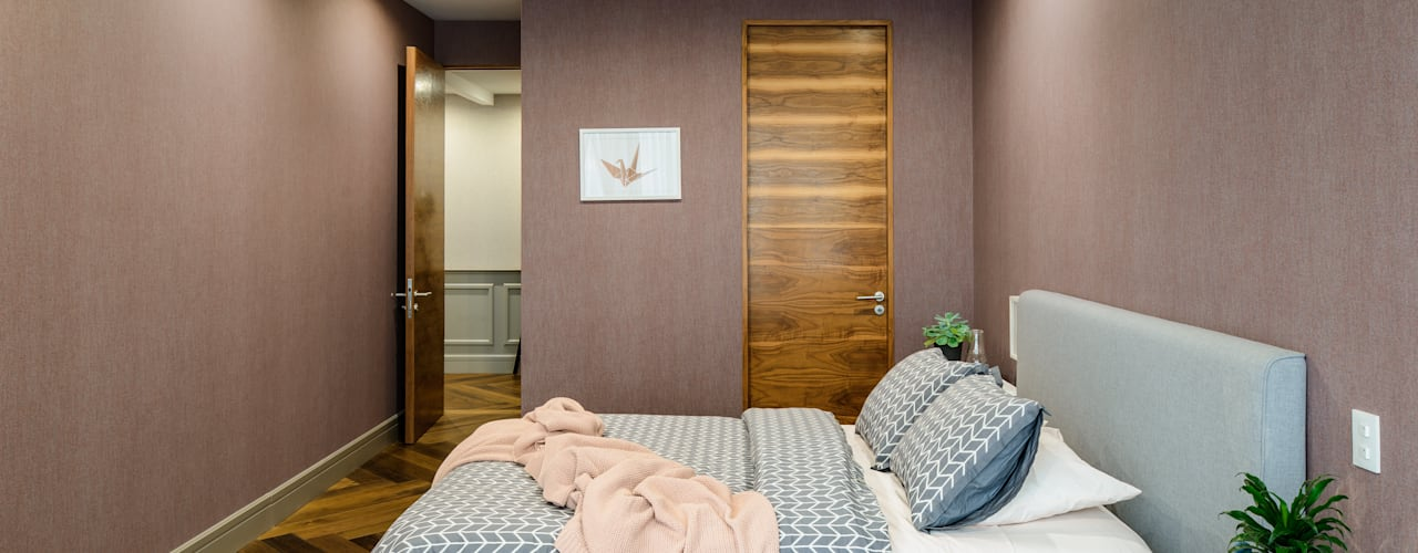 Dormitorios de estilo clásico de NIVEL TRES ARQUITECTURA Clásico