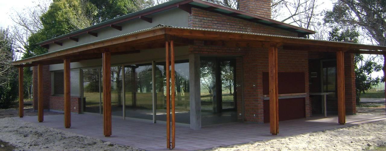 Casas de estilo  por Marcelo Manzán Arquitecto