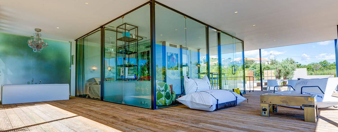 Nomad Living studioarte Modern balcony, veranda & terrace