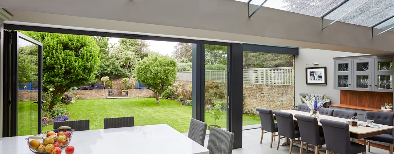 The reconstruction and enlargement of a dilapidated extension to the rear of a Victorian home Modern kitchen by Trombe Ltd Modern