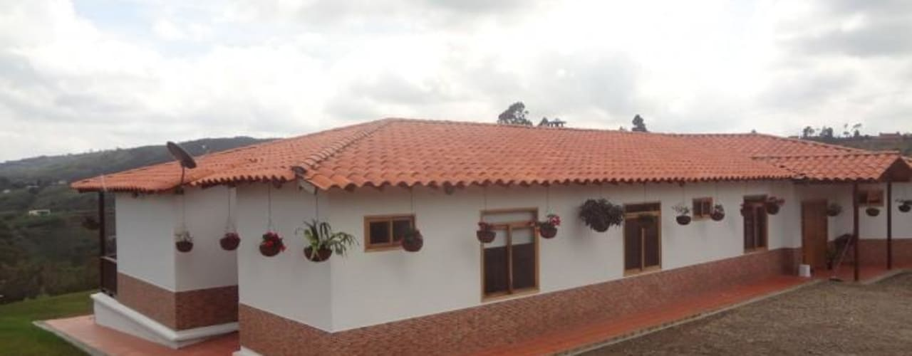 Projekty, wiejskie Domy zaprojektowane przez PREFABRICASA