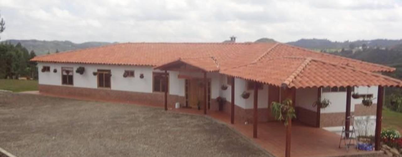 Houses by PREFABRICASA , Tropical