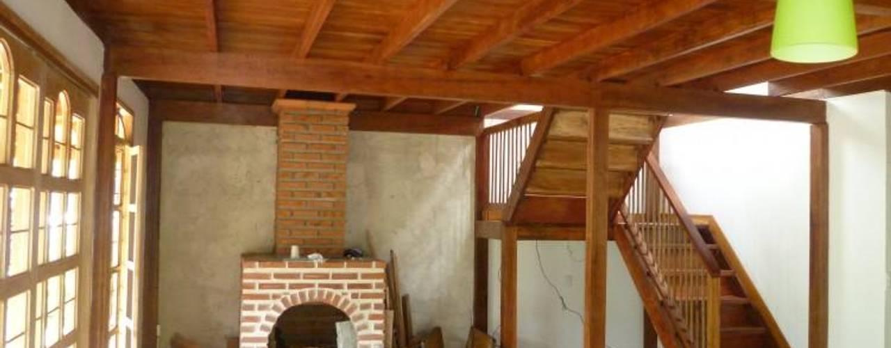 Casa pre fabricada en bogotá 2: Salas de estilo  por PREFABRICASA , Moderno