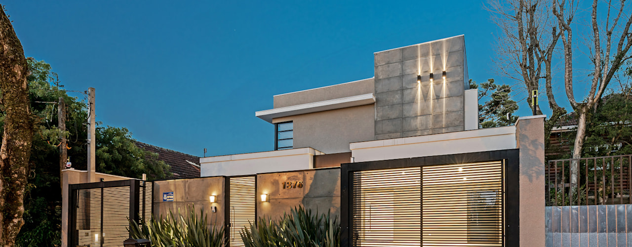 Casas de estilo moderno por TRÍADE ARQUITETURA
