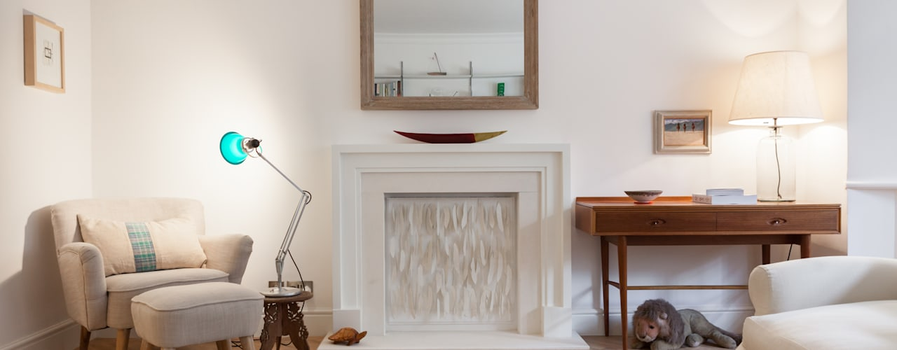 Limestone fireplace: eclectic Living room by Timothy James Interiors