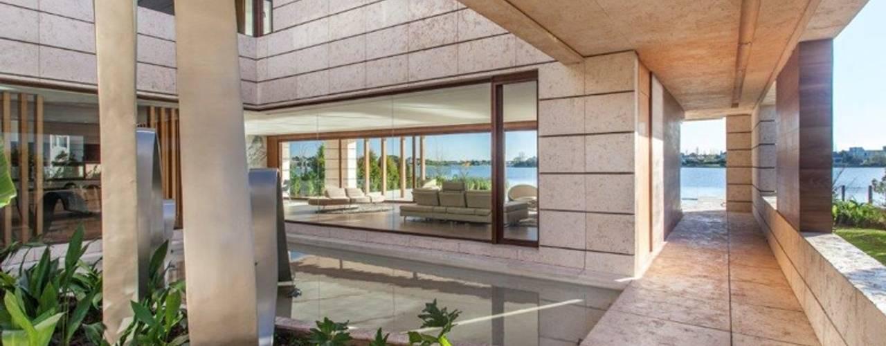 Abstracción Líquida: Pasillos y recibidores de estilo  por CIBA ARQUITECTURA