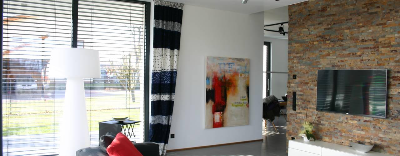 Гостиная в . Автор – Heinz von Heiden GmbH Massivhäuser