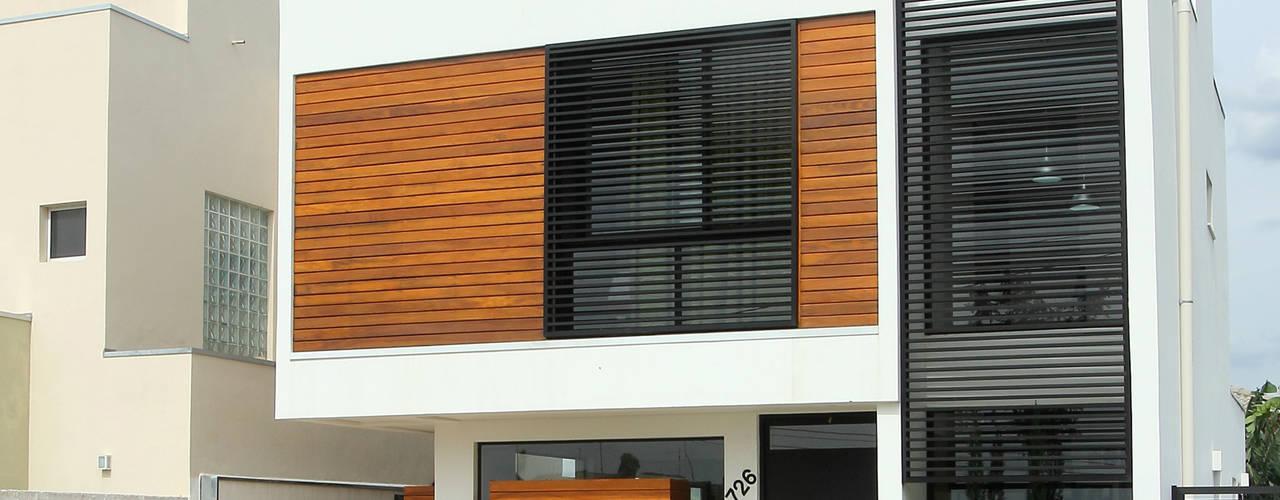 Casa AT Casas modernas por Taguá Arquitetura Moderno