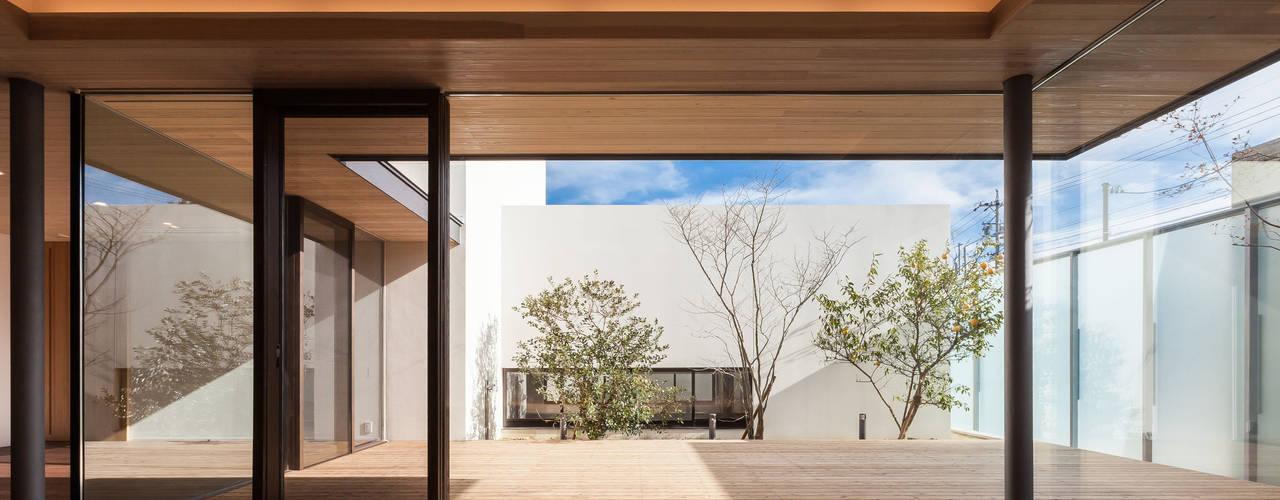 神沢の家 Architet6建築事務所 ミニマルデザインの リビング ガラス ベージュ