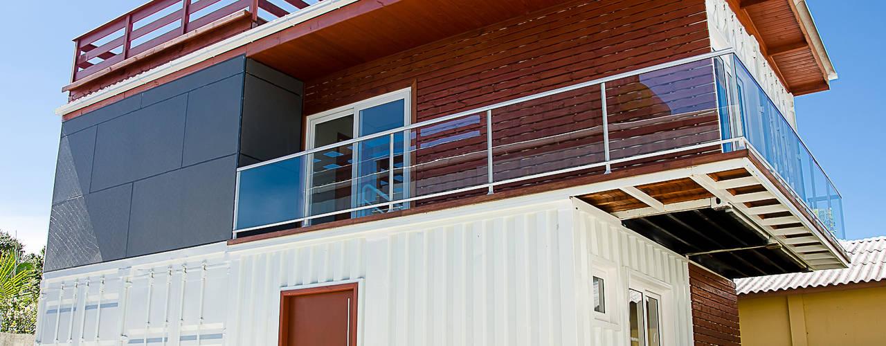 GhiorziTavares Arquitetura Case in stile minimalista Ferro / Acciaio