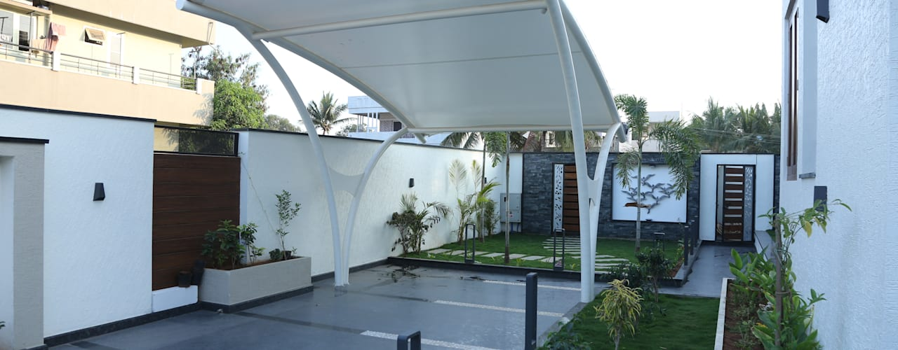 Garajes de estilo moderno por Hasta architects