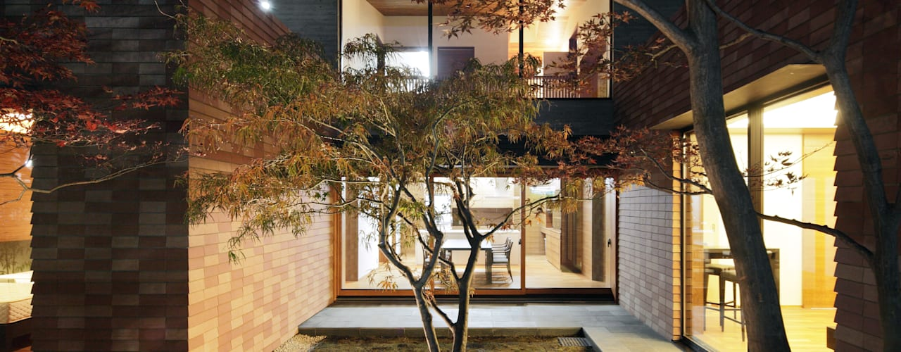 Jardin de style  par カトウアーキテクトオフィス,