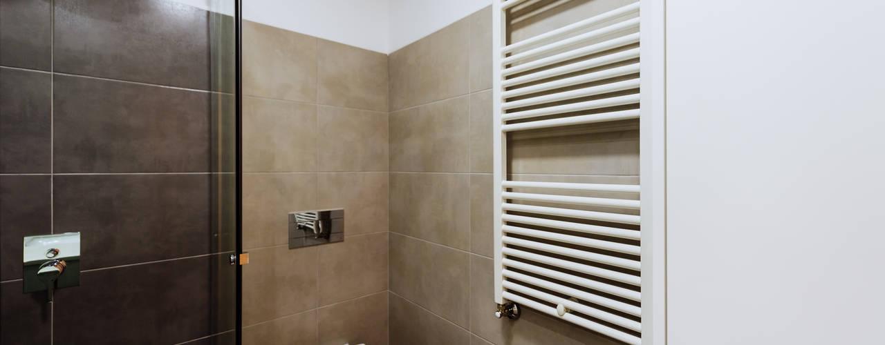 حمام تنفيذ NOVACOBE - Construção e Reabilitação, Lda.