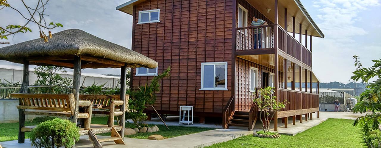 Casas de estilo  por 鄉村東和鋼構木屋,