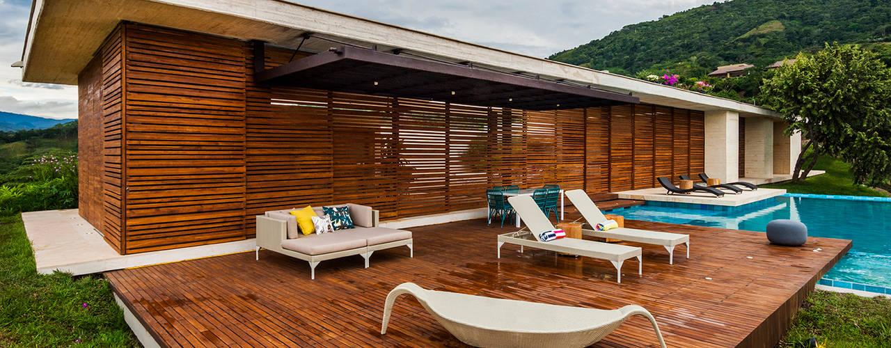 Arquitectura en Estudio Casas estilo moderno: ideas, arquitectura e imágenes Madera Acabado en madera