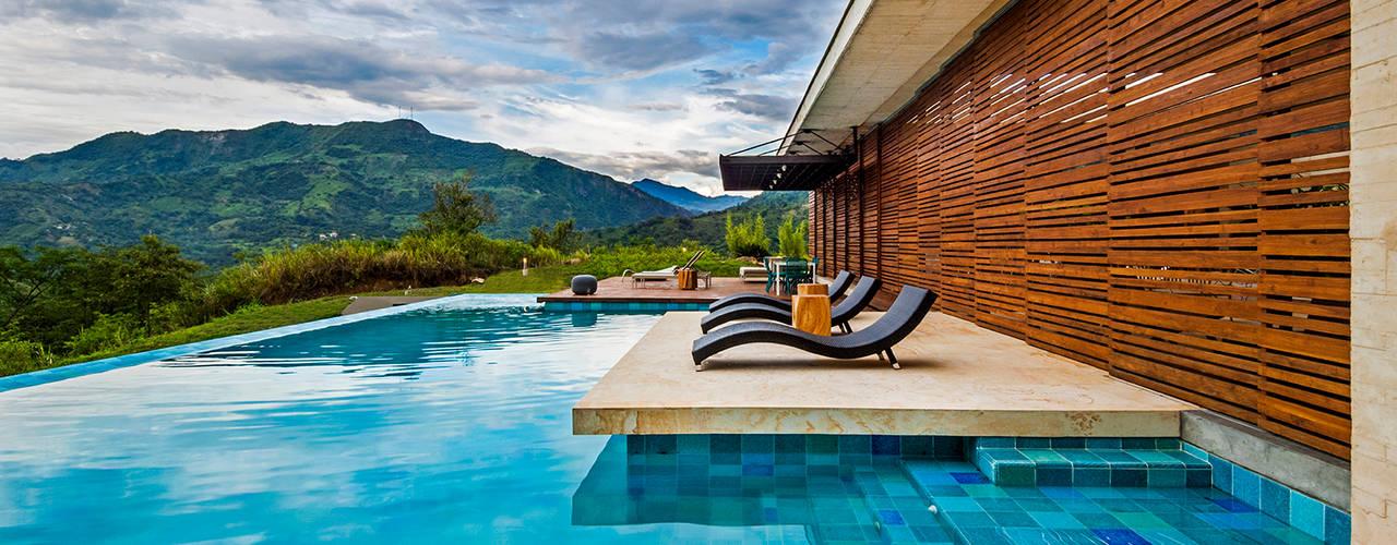 Modern houses by Arquitectura en Estudio Modern
