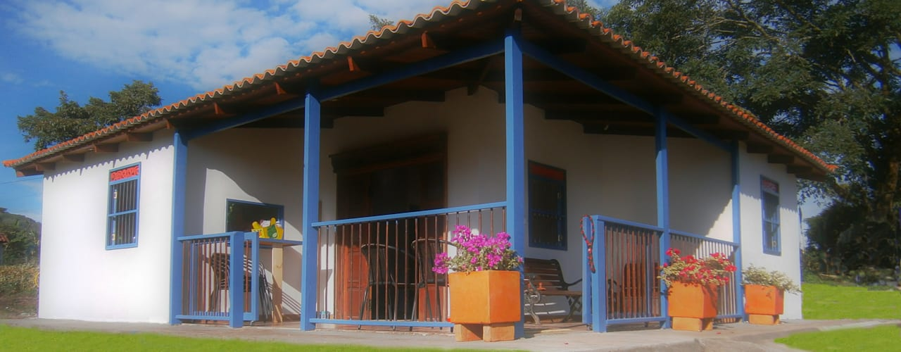 Casas de estilo rural de Construexpress Rural