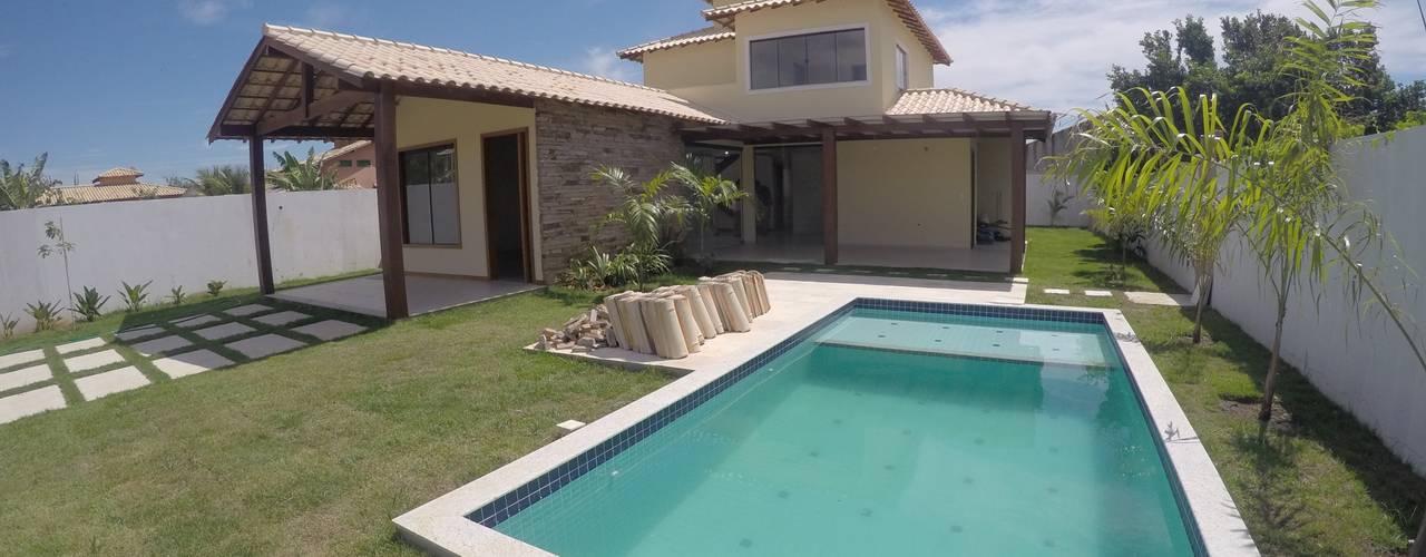Piscinas de estilo tropical de Aroeira Arquitetura Tropical
